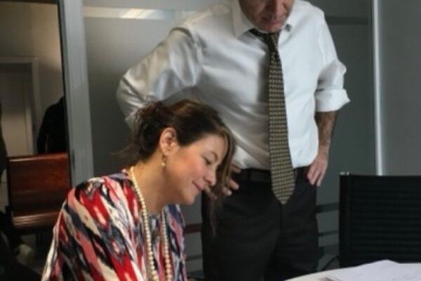 Melissa signing her citizenship paperwork.